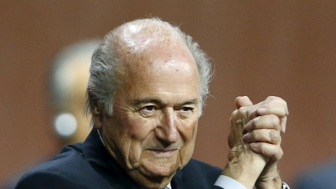 File photo shows FIFA President Sepp Blatter gesturing after he was re-elected at the 65th FIFA Congress in Zurich