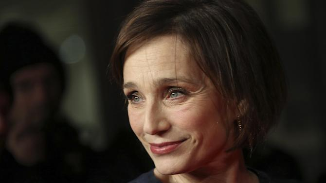 "FILE - This is a Monday, Jan. 27, 2014 file photo of British actress Kristin Scott Thomas as she arrives on the red carpet for the British Premiere of ""The Invisible Woman"" at a cinema in west London. Producers announced Friday Oct. 31, 2014 that Scott Thomas will star as Queen Elizabeth II in a new West End production of ""The Audience."" (AP Photo by Joel Ryan/Invision, File)"