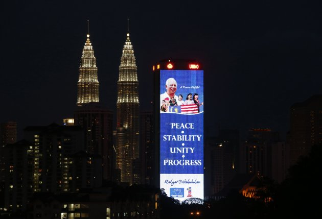 File photo of a giant image of Malaysia's PM Najib Razak with an election campaign message displayed on the facade of his United Malays National Organisation headquarters in Kuala Lumpur