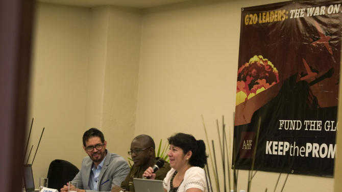 From left, Dr. Jorge Saavedra, Cheick Tidiane Tall, and Patricia Campos give a press conference on Saturday, June 16, 2012 in Los Cabos, Mexico. (Fernando Castillo/AP Images for AIDS Healthcare Foundation)