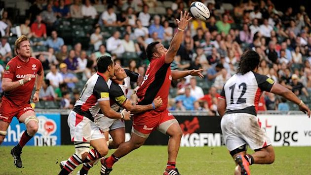 Saracens' Mako Vunipola tries to catch the ball during a rugby union match of the Chartis Cup between Saracens and the Asia-Pacific Barbarians in Hong Kong on June 9, 2012 (AFP)