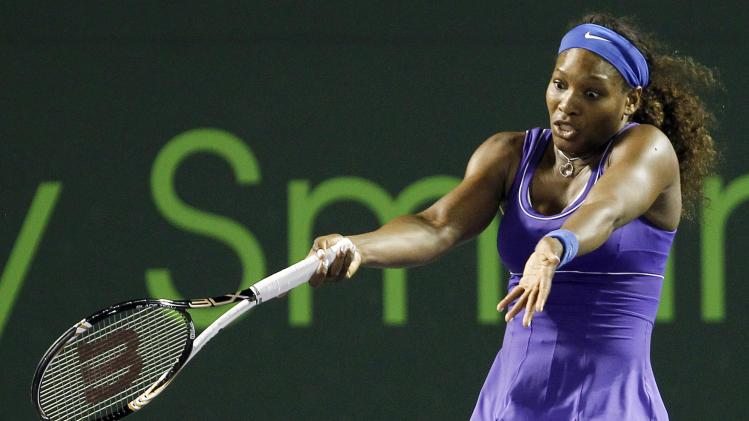 Serena Williams, of the United States, reacts after losing a point to Caroline Wozniacki, of Denmark, during the Sony Ericsson Open tennis tournament in Key Biscayne, Fla., Tuesday, March 27, 2012. Wozniacki won 6-4, 6-4. (AP Photo/Alan Diaz)
