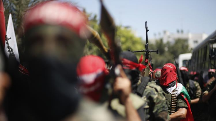 Palestinian militants from the Popular Front for the Liberation of Palestinian take part in a military show in Gaza City