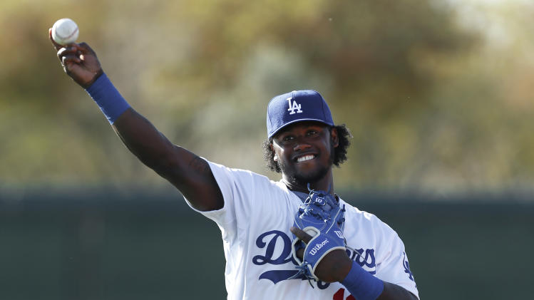 Los Angeles Dodgers shortstop Hanley Ramirez throws during spring training baseball practice in Glendale, Ariz., Friday, Feb. 14, 2014. (AP Photo/Paul Sancya)