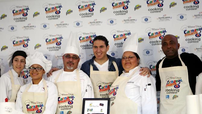 "IMAGE DISTRIBUTED FOR BOUNTY- In this image released on Tuesday, March 5, 2013, Chef James and contestants go head-to-head to see who will be named the Bounty Select-A-Size ""Tastiest Mess in Miami"" category at the Carnaval Miami Cooking Contest in Miami. (Marc Serota/AP Images for Bounty)"