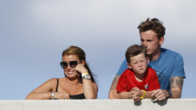 Wife of England's Wayne Rooney, Coleen Rooney and son Kai (2nd R) before the match