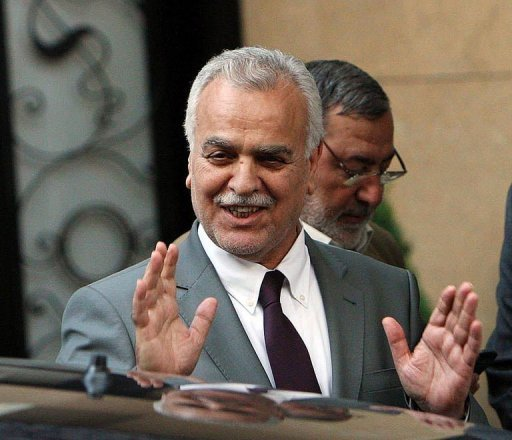 "<p>Iraqi fugitive Vice President Tareq al-Hashemi waves to reporters after meeting Turkey's Foreign Minister Ahmet Davutoglu in Ankara. Hashemi has rejected his murder conviction and death sentence and ruled out returning home until he is guaranteed ""security and a fair trial"".</p>"