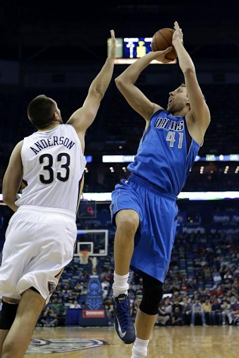 Dallas Mavericks power forward Dirk Nowitzki (41) shoots over New Orleans Pelicans power forward Ryan Anderson (33) in the first half of an NBA basketball game in New Orleans, Wednesday, Dec. 4, 2013