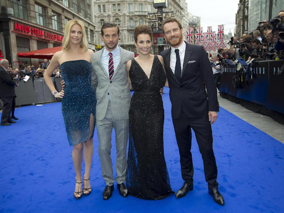 From left, actors Charlize Theron, Logan Marshall-Green, Noomi Rapace and Michael Fassbender arrive at a central London cinema for the World Premiere of Prometheus, Thursday, May 31, 2012. (AP Photo/Joel Ryan)