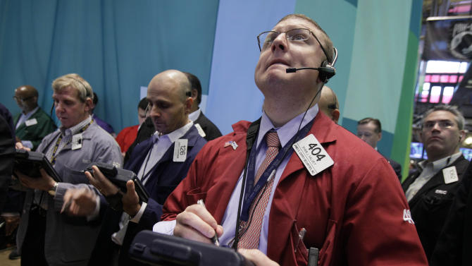 Trader Ryan Falvey, foreground right, works on the floor of the New York Stock Exchange Friday, Aug. 3, 2012. U.S. stocks are rising sharply on Wall Street after a July jobs report revealed the strongest hiring trends in five months. (AP Photo/Richard Drew)