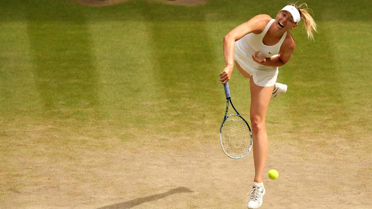 Russia's Maria Sharapova returns to Germany's Angelique Kerber during their women's singles fourth round match on day eight of the 2014 Wimbledon Championships at The All England Tennis Club in Wimbledon, southwest London, on July 1, 2014