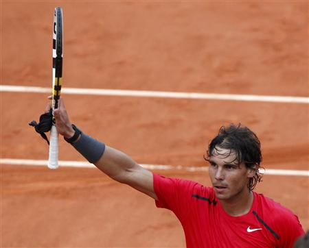 Nadal of Spain celebrates after winning his match against Schwank of Argentina during the French Open tennis tournament at the Roland Garros stadium in Paris