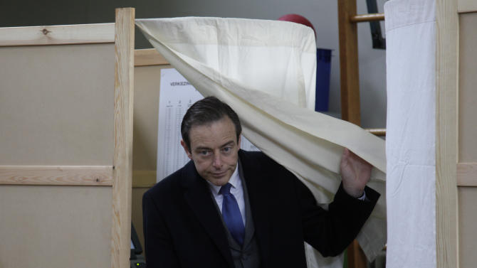 Leader of the NVA party Bart De Wever leaves the booth after casting his vote at a polling station in Antwerp, Belgium, on Sunday Oct. 14, 2012. NVA, a separatist party, wants to use Antwerp as a base for breaking away from Belgium, putting it in the forefront of a European breakaway trend just as the EU celebrates winning the Nobel Peace Prize for fostering continental unity. (AP Photo/Virginia Mayo)