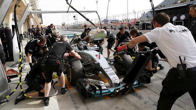 Mercedes Formula One Driver Nico Rosberg of Germany returns to pit lane during the third free practice ahead of Bahrain's F1 Grand Prix at Bahrain International Circuit, south of Manama