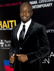 "FILE - This Sept. 20, 2011 file photo shows musician Wyclef Jean attending a party to benefit Donna Karan's Hope, Help and Rebuild Haiti charity in New York. Jean has written an autobiography, ""Purpose"" which is on sale Tuesday, Sept. 18, 2012. (AP Photo/Charles Sykes, file)"