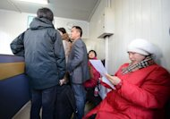 Parents crowd a Beijing office on November 29, 2012, waiting for an education official. Cities such as Beijing that host China&#39;s best universities -- and large incomer populations -- only allow those with official residency permits, or &quot;hukou&quot;, to take their exam and benefit from preferential quotas for places