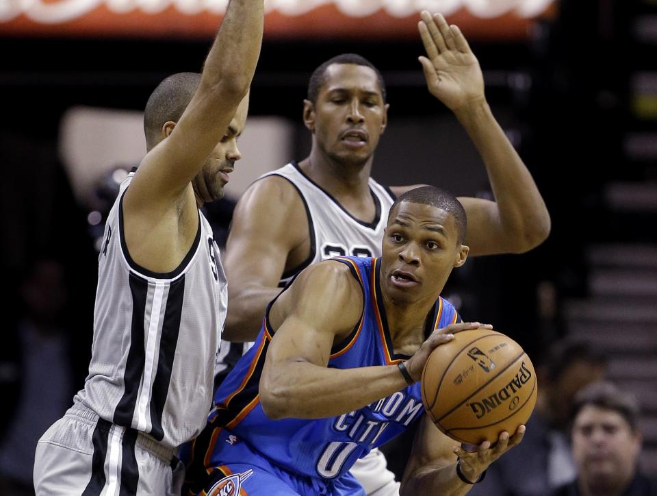 Oklahoma Thunder's Russell Westbrook (0) is pressured by San Antonio Spurs' Tony Parker, left, of France, and Boris Diaw, center, of France, during the first quarter of an NBA basketball game, Thursday, Nov. 1, 2012, in San Antonio. (AP Photo/Eric Gay)
