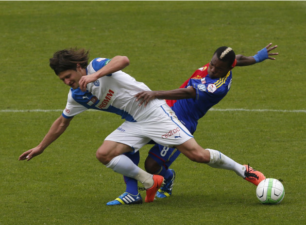 Grasshopper's Saltic fights for the ball with FC Basel's Die in Swiss Cup final soccer match in Bern