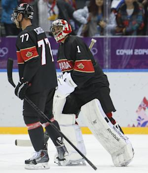 =Canada forward Jeff Carter, left, and Canada goaltender Roberto Luongo skate off the ice together after beating Austria 6-0 in a men's ice hockey game at the 2014 Winter Olympics, Friday, Feb. 14, 2014, in Sochi, Russia. Carter scored a hat trick in the game and Luongo recorded a shutout