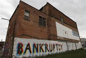 """The word """"Bankruptcy"""" is painted on the side of a building in Detroit, Michigan"""