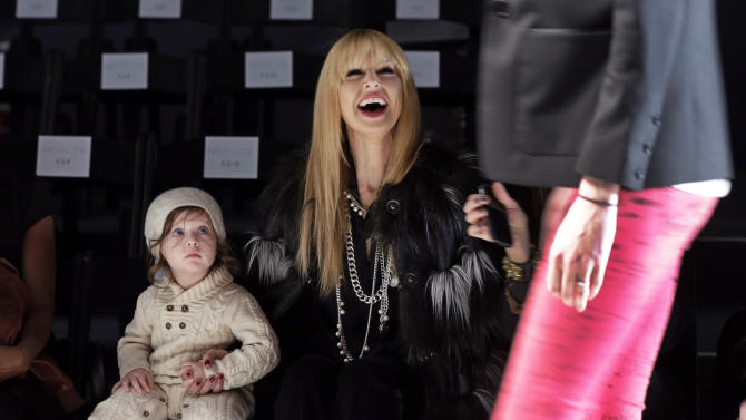 Designer Rachel Zoe and her son Skyler watch a rehearsal of her Fall 2013 collection during Fashion Week in New York, Wednesday, Feb. 13, 2013. (AP Photo/Richard Drew)