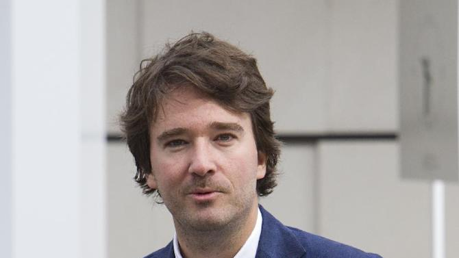 """LVMH member of the board of directors Antoine Arnault, attends """"Particular operation days"""" in LVMH,  the world's largest luxury company at the factory of Vuitton, in Asnieres, France, north of Paris,  Saturday June 15, 2013.(AP Photo/Jacques Brinon)"""