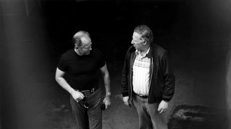 """This 1980 black and white surveillance photo released by the U.S. Attorney's Office and presented as evidence during the first day of a trial for James """"Whitey"""" Bulger in U.S. District Court in Boston, Wednesday, June 12, 2013, shows Bulger, left, with George Kaufman at a Lancaster Street garage in Boston's North End. Bulger is on trial for a long list of crimes, including extortion and playing a role in 19 killings. (AP PhotoU.S. Attorney's Office)"""