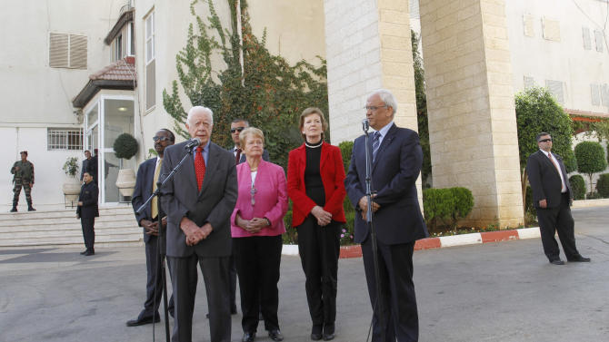 Former US President Jimmy Carter, left, and chief Palestinian negotiator Saeb Erekat, right, speak to the media with Mary Robinson, former United Nations High Commissioner for Human Rights, second right, and Gro Harlem Brundtland, Norway's first woman Prime Minister, third right, following their meeting with Palestinian President Mahmoud Abbas in the West Bank city of Ramallah, Monday, Oct. 22, 2012. The Elders are visiting the region and holding meetings with Israeli and Palestinian leaders. (AP Photo/Nasser Shiyoukhi)