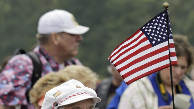 Ethel Stevanus of Wellersburg, Pa. sings along to a patriotic medley during the dedication of phase I of the permanent Flight 93 National Memorial near the crash site of Flight 93 in Shanksville, Pa. Saturday Sept. 10, 2011.  (AP Photo/Amy Sancetta)