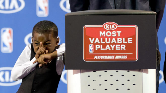 Miami Heat's LeBron James' son, Bryce, reacts as his father speaks during an NBA basketball news conference, Sunday, May, 5, 2013, in Miami. James was formally announced as having won his fourth Most Valuable Player award Sunday. (AP Photo/J Pat Carter)