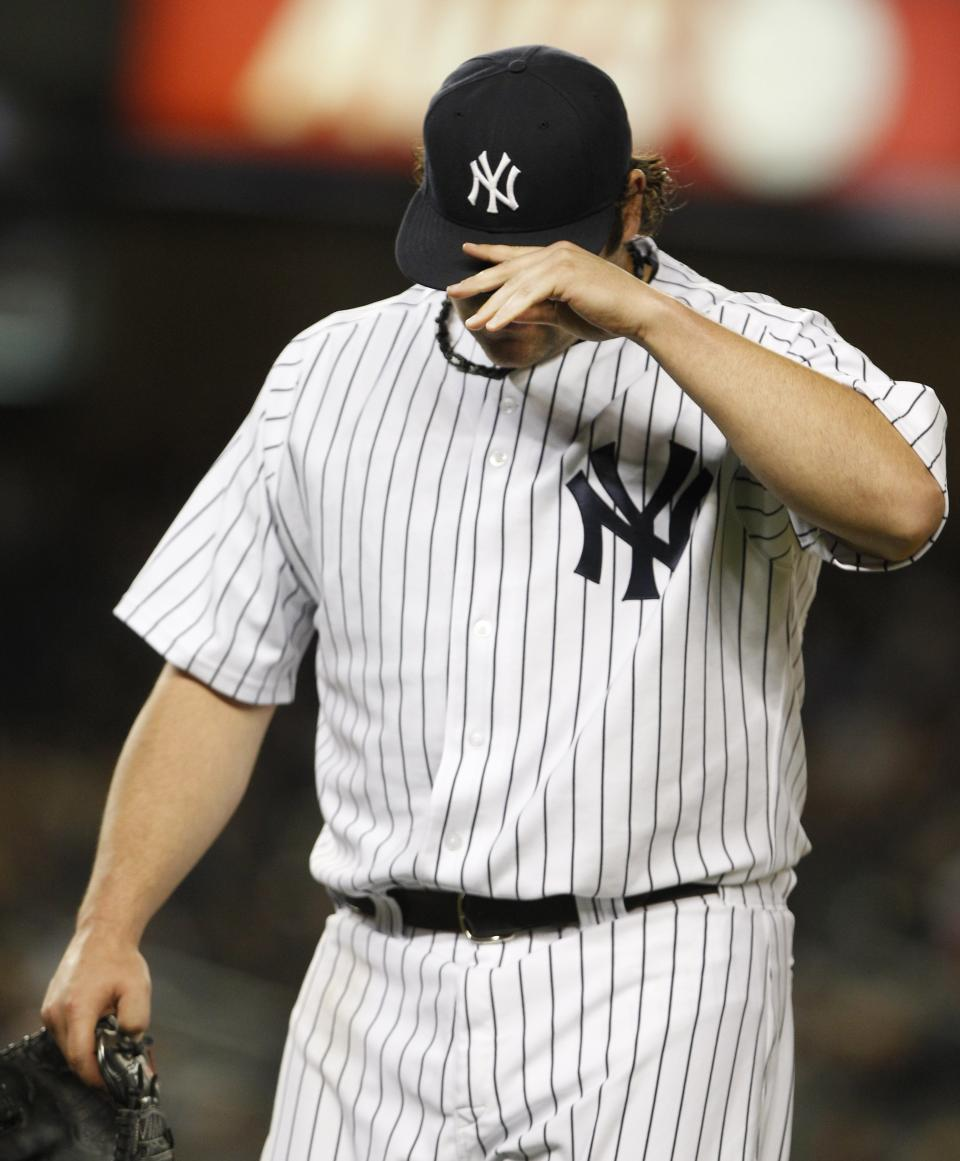 New York Yankees relief pitcher Joba Chamberlain adjusts his hat as he leaves the field after the seventh inning of a baseball game against the Boston Red Sox Friday, May 13, 2011, at Yankee Stadium in New York. (AP Photo/Frank Franklin II)