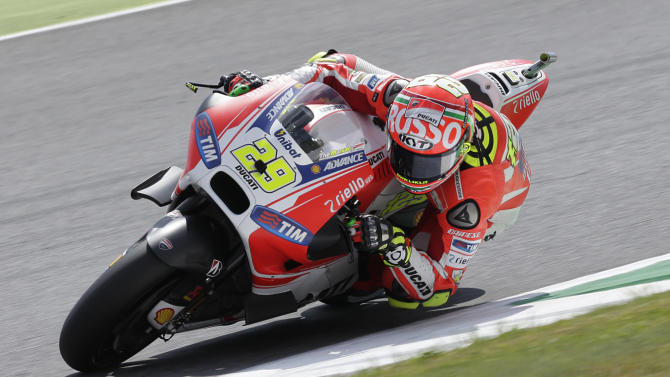 Ducati's rider Andrea Iannone takes a curve on his way to clinch the pole position during the Italian MotoGP qualifying session, at the Mugello race circuit, in Scarperia, Italy, Saturday, May 30, 2015. (AP Photo/Gregorio Borgia)