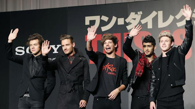 "FILE - In this Nov. 3, 2013 file photo, One Direction members, from left, Harry Styles, Liam Payne, Louis Tomlinson, Zayn Malik and Niall Horan, wave during an event for their film ""One Direction: This Is US,"" in Makuhari, near Tokyo. Chart-topping boy band One Direction says Zayn Malik has left the group. The band confirmed his departure Wednesday, March 25, 2015 in a statement. (AP Photo/Koji Sasahara, File)"