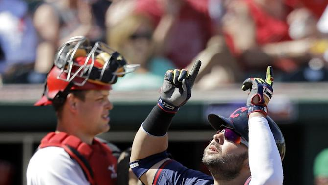 Reds score 2 in 9th to rally past Indians