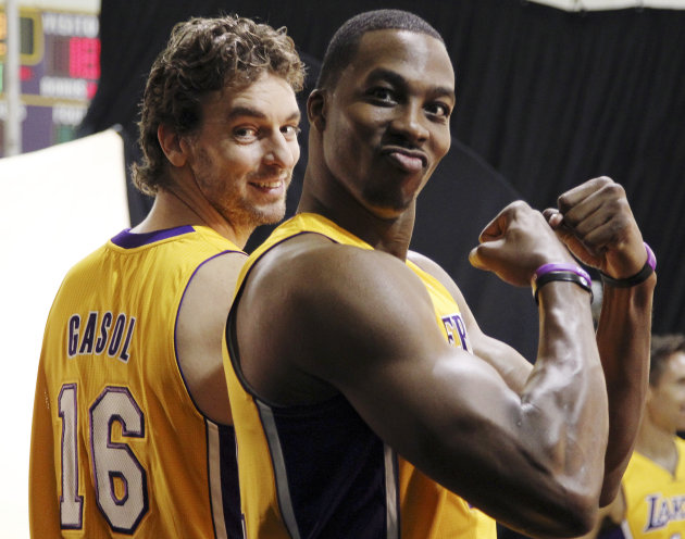 Los Angeles Lakers forward Pau Gasol (16) and center Dwight Howard pose during their NBA basketball media day at the team's headquarters in El Segundo, Calif., Monday, Oct. 1, 2012. (AP Photo/Reed