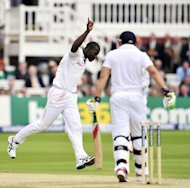 West Indies' cricketer Marlon Samuels (left) celebrates taking the wicket of England's Tim Bresnan for a duck during the third day of the first Test against England at Lord's cricket ground in London, England on May 19. England were dismissed for 398 in reply to the West Indies' 243, a first innings lead of 155 runs