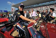 Red Bull-Renault driver Sebastian Vettel of Germany was in relaxed mood during the drivers&#39; parade prior to the Japanese Grand Prix at the Suzuka circuit. Vettel, the double defending world champion who won last month in Singapore to rise to second in the standings, claimed his fourth pole in a row in Japan