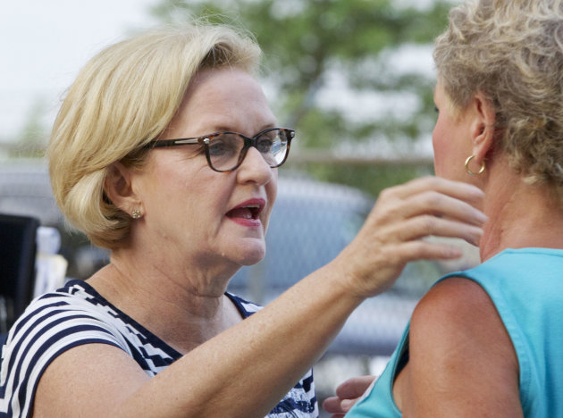 FILE - In this Aug. 16, 2012 file photo, Sen. Claire McCaskill, D-Mo., talks with a supporter at the Governor's Ham Breakfast at the Missouri State Fair. McCaskill has been clearly uncomfortable discussing Akin's plight publicly, but she has been steadfast in her insistence that he should not be forced out. (AP Photo/Orlin Wagner, File)