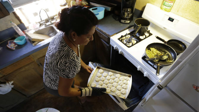 Sonia Limas, an illegal immigrant, makes cookies at her home, Thursday, Sept. 6, 2012, in Alamo, Texas. When healthcare reform has been fully implemented, illegal immigrants will make up the nation's second-largest population of uninsured, or about 25 percent. The only larger group will be people who qualify for insurance but fail to enroll, according to a 2012 study by the Washington-based Urban Institute. (AP Photo/Eric Gay)