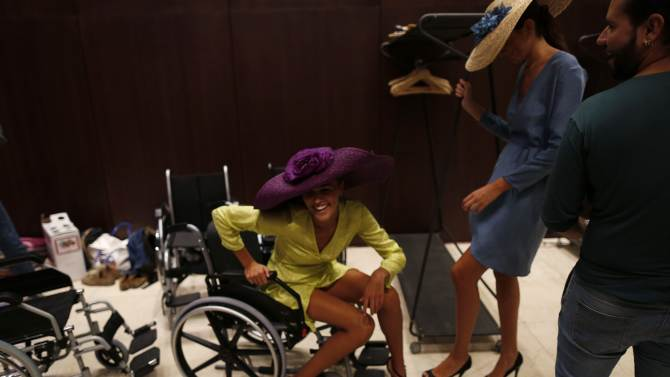 Spanish model rises from a wheelchair backstage during the CODE 41 Trending Day, a fashion show in the Andalusian capital of Seville
