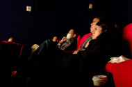 "In this Feb. 6, 2013 photo, Taiwanese movie goers sit in a nearly empty theater to watch Oscar nominated ""Zero Dark Thirty"" as the Chinese New Year nears in Taipei, Taiwan. Tens of millions of film fanatics are entering theaters around Asia during the long Lunar New Year holiday, but Hollywood can't count on them to boost the box office for its mostly serious Oscar nominees. Even with the Academy Awards buzz at a peak barely two weeks before the ceremony, patrons are opting for lighter fare. (AP Photo/Wally Santana)"