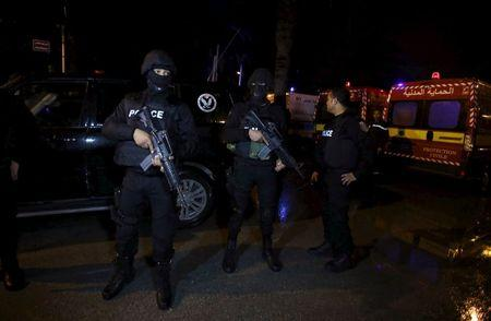Tunisian police officers are pictured after an attack on a military bus in Tunis, Tunisia