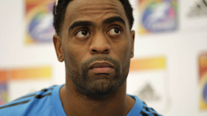 Injured U.S. sprinter Tyson Gay takes part in a news conference for the World Athletics Championships at the stadium in Daegu, South Korea, Thursday, Aug. 25, 2011.   The World Athletics Championships run Aug. 27 through Sept. 4, 2011 in Daegu. (AP Photo/Matt Dunham)