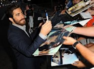 "Actor Jake Gyllenhaal arrives at the premiere of Open Road Films' ""End of Watch"" at Regal Cinemas L.A. Live on September 17, in Los Angeles, California. Los Angeles cop drama ""End of Watch"" and horror-thriller flick ""House at the End of the Street,"" jointly topped the North American box office on their debut weekend, estimates showed Sunday"