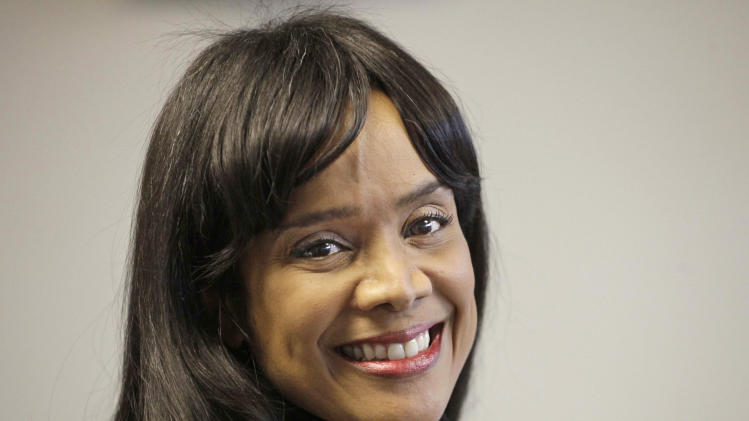 FILE - In this Feb. 16, 2011 file photo, Chicago Alderman Sandi Jackson, wife of U.S. Rep. Jesse Jackson Jr., is seen in her Chicago office. On Friday, Feb. 15, 2013, Sandi Jackson, who resigned from the City Council in January 2013, was charged with filing false joint tax returns. Her husband was charged with spending $750,000 in campaign funds on personal expenses. (AP Photo/M. Spencer Green, File)