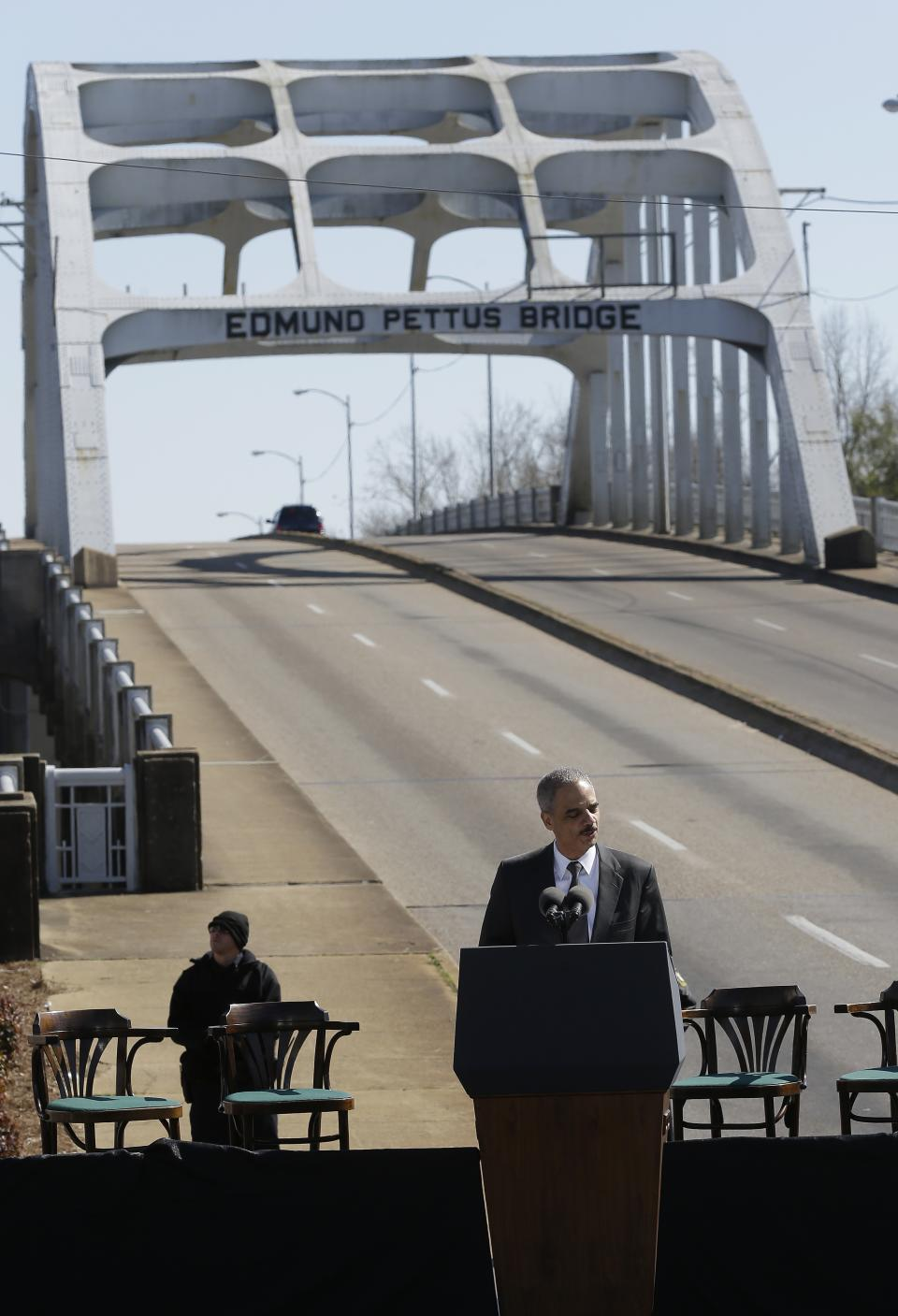 U.S. Attorney General Eric Holder addresses those who gathered for the Bridge Crossing Jubilee in Selma, Ala., Sunday, March 3, 2013. They were commemorating the 48th anniversary of Bloody Sunday, when police officers beat marchers when they crossed the bridge on a march from Selma to Montgomery. (AP Photo/Dave Martin)