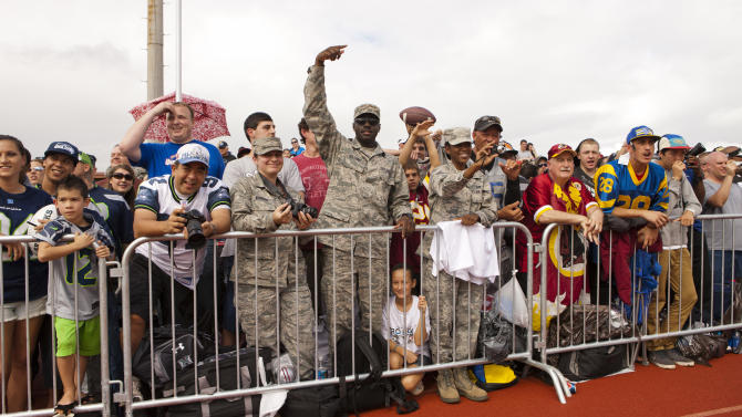 In this picture provided by USAA, fans watch the NFC team during NFL Pro Bowl Practice at Joint Base Pearl Harbor Hickam, Thursday, Jan. 24. 2013 in Honolulu.  (Marco Garcia/AP Images for USAA)