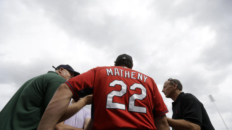 St. Louis Cardinals manager Mike Matheny (22) talks to reporters before an exhibition baseball game against the Boston Red Sox in Fort Myers, Fla., Monday, March 17, 2014. (AP Photo/Gerald Herbert)