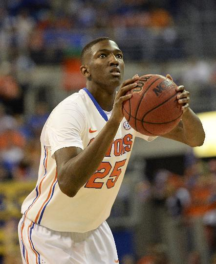 Florida guard/forward DeVon Walker (25) prepares to shoot a free throw during the first half of an NCAA college basketball game against Kentucky  Saturday, March 8, 2014 in Gainesville, Fla.  Florida won the game 84-65