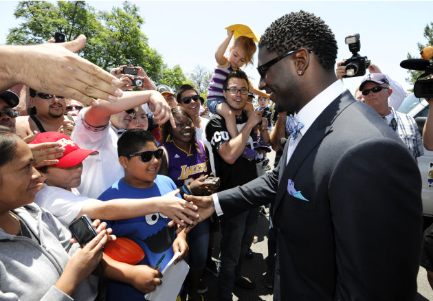 Former San Diego Chargers running back LaDainian Tomlinson shakes hands with fans after a news conference held at the San Diego Chargers facility Monday, June 18, 2012 in San Diego. Tomlinson signed a